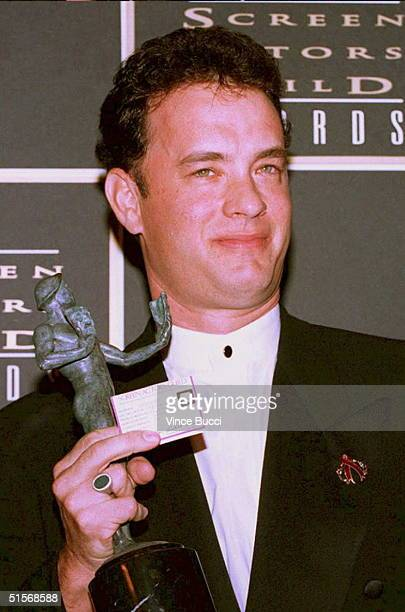 "Actor Tom Hanks holds his award for outstanding performance, male actor in a leading role for his part in the movie ""Forrest Gump"" during the..."