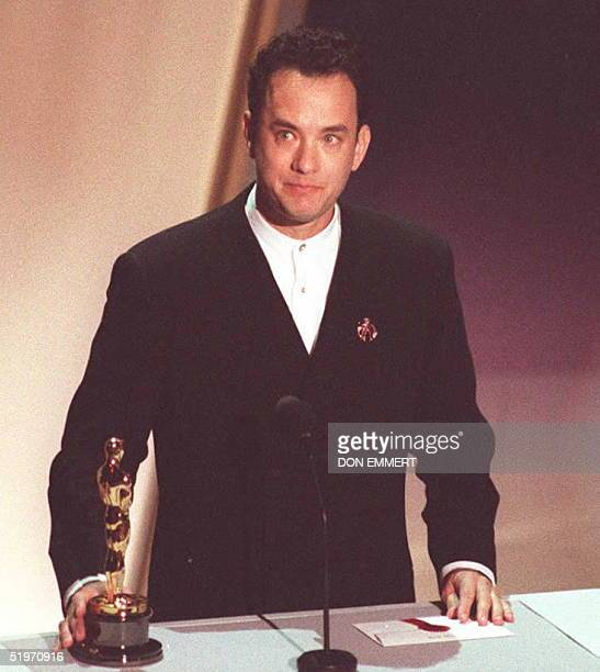 US actor Tom Hanks holds his Oscar 27 March as he speaks to the audience at the 67th annual Academy Awards in Los Angeles Hanks won best actor for...