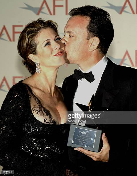 Actor Tom Hanks kisses wife actress Rita Wilson after he received the 30th AFI Life Achievement Award June 12 2002 in Hollywood California The event...