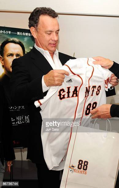 Actor Tom Hanks looks at a Giants shirt at the reception room during professional baseball match between Yomiuri Giants and Chunichi Dragons at Tokyo...