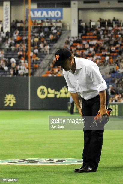 Actor Tom Hanks looks on during the ceremonial first pitch prior to the professional baseball match between Yomiuri Giants and Chunichi Dragons at...