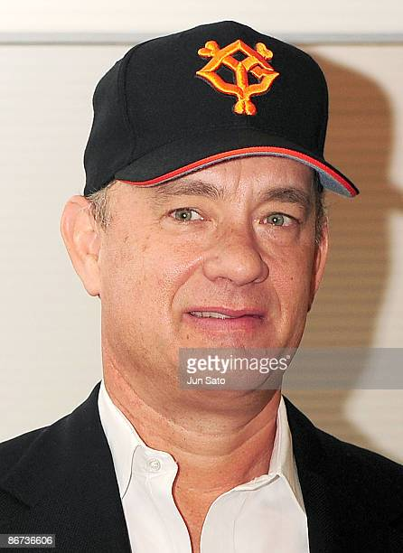 Actor Tom Hanks poses for a photograph before throwing the ceremonial first pitch prior to the professional baseball match between Yomiuri Giants and...