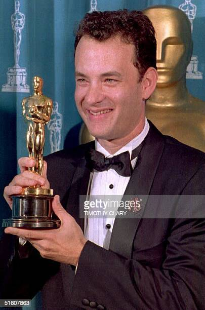 US actor Tom Hanks poses with his Oscar 21 March during the 66th Annual Academy Awards ceremony after winning the 1993 award for best actor for his...