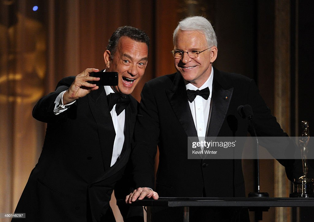 Actor Tom Hanks presents Honoree Steve Martin with honorary award onstage during the Academy of Motion Picture Arts and Sciences' Governors Awards at The Ray Dolby Ballroom at Hollywood & Highland Center on November 16, 2013 in Hollywood, California.