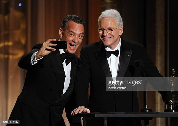 Actor Tom Hanks presents Honoree Steve Martin with honorary award onstage during the Academy of Motion Picture Arts and Sciences' Governors Awards at...
