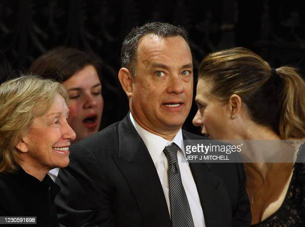 Actor Tom Hanks reacts prior to a speech by US President Barack Obama alongside Doris Kearns Goodwin and Rita Wilson at the British Parliament on May...