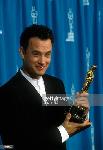 Actor Tom Hanks receives his Oscar at the Academy Awards in Los Angeles, CA., March 29, 1995.