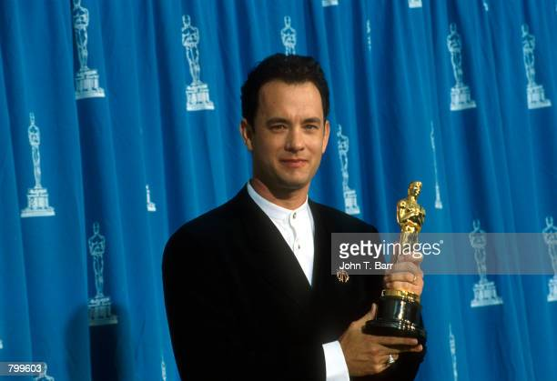 Actor Tom Hanks receives his Oscar at the Academy Awards in Los Angeles, CA., March 27, 1995.