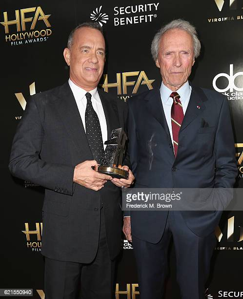 Actor Tom Hanks recipient of the 'Hollywood Actor Award' for 'Sully' and presenter Clint Eastwood pose in the press room at the 20th Annual Hollywood...