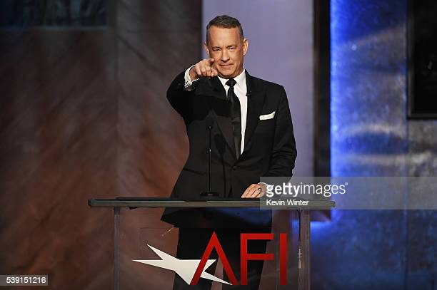 Actor Tom Hanks speaks onstage during American Film Institute's 44th Life Achievement Award Gala Tribute to John Williams at Dolby Theatre on June 9...