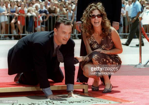 Actor Tom Hanks with his hands in cement 23 July 1998 during ceremonies honoring him on Hollywood's Walk of Fame in front of Graumann's Chinese...