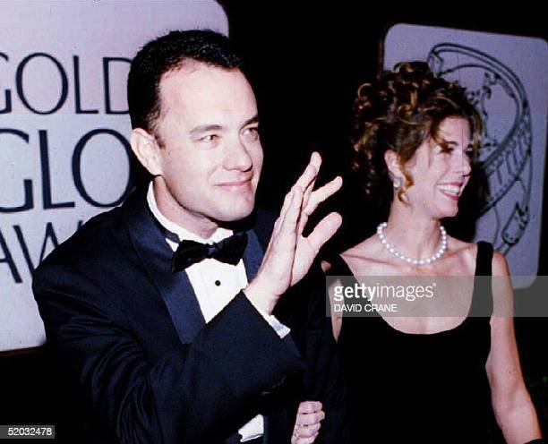 US actor Tom Hanks with his wife Rita waves to photographers as they arrive for the 51st Golden Globe Awards 22 January 1994 in Beverly Hills CA...