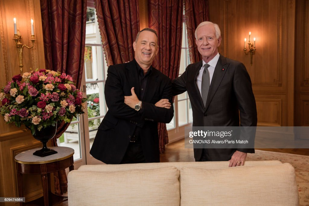 Actor Tom Hanks with retired commercial pilot Chesley Sullenberger are photographed for Paris Match on November 18, 2016 in Paris, France.