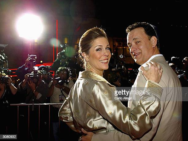Actor Tom Hanks with wife Rita Wilson arrives the world premiere of his movie 'Ladykillers' at the El Capitan Theatre March 12 2004 in Hollywood CA...