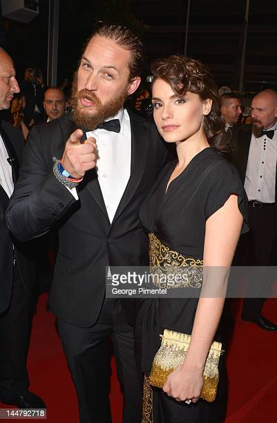 Actor Tom Hardy and partner Charlotte Riley attend the 'Lawless' Premiere during the 65th Annual Cannes Film Festival at Palais des Festivals on May...