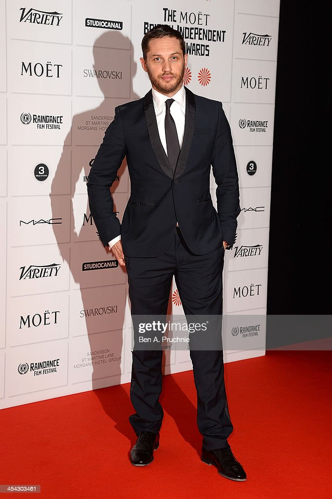Actor Tom Hardy arrives on the red carpet for the Moet British Independent Film Awards at Old Billingsgate Market on December 8, 2013 in London, England.