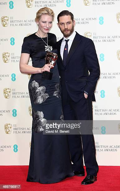 Actor Tom Hardy poses with actress Cate Blanchett after presenting her with the Best Actress award in the winners room at the EE British Academy Film...
