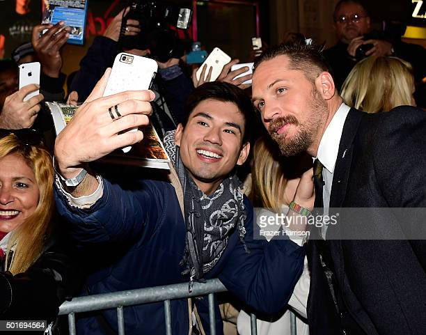 Actor Tom Hardy poses with fans during the premiere of 20th Century Fox and Regency Enterprises' The Revenant at the TCL Chinese Theatre on December...