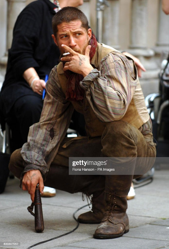 Actor Tom Hardy takes a break from filming his role as Bill Sykes in a BBC production of Oliver Twist scheduled for later this year, outside the High Court in central London today.