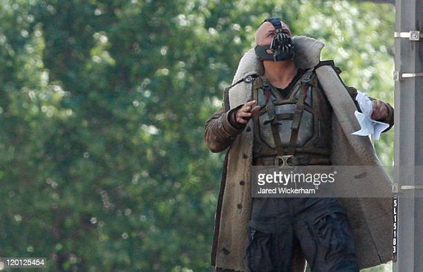 Actor Tom Hardy who plays the villian Bane acts in a scene on the set of 'The Dark Knight Rises' filming near the Carnegie Mellon University Software...