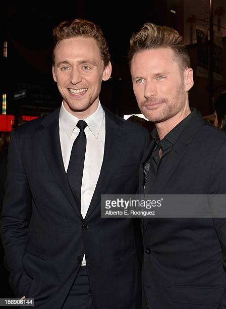 Actor Tom Hiddleston and composer Brian Tyler attend Marvel's Thor The Dark World Premiere at the El Capitan Theatre on November 4 2013 in Hollywood...