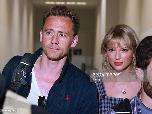 Actor Tom Hiddleston and singer Taylor Swift arrive at Sydney International Airport in Sydney New South Wales The couple are then believed to have...
