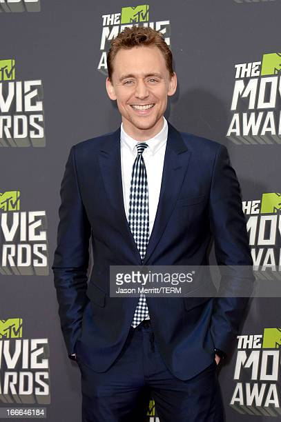 Actor Tom Hiddleston arrives at the 2013 MTV Movie Awards at Sony Pictures Studios on April 14 2013 in Culver City California
