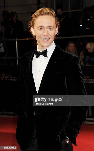 Actor Tom Hiddleston arrives at the Orange British Academy Film Awards 2012 at The Royal Opera House on February 12 2012 in London England