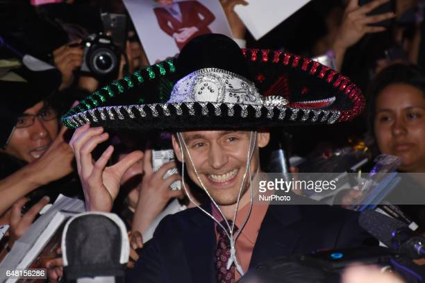 Actor Tom Hiddleston Is seen he putting on a traditional hat of Mexico called 'Charro' during the red carpet film premiere of Kong Skull Island at...