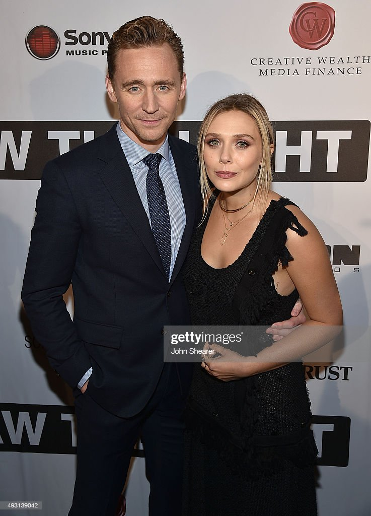 Actor Tom Hiddleston, left, and actress Elizabeth Olsen attend the premiere of 'I Saw The Light' at The Belcourt Theatre on October 17, 2015 in Nashville, Tennessee.