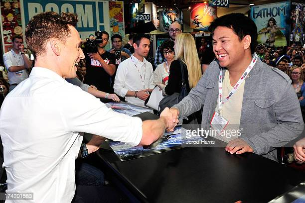 Actor Tom Hiddleston shakes a fans hand at Marvel's 'Thor The Dark World' Autograph Signing ComicCon International 2013 on July 21 2013 in San Diego...