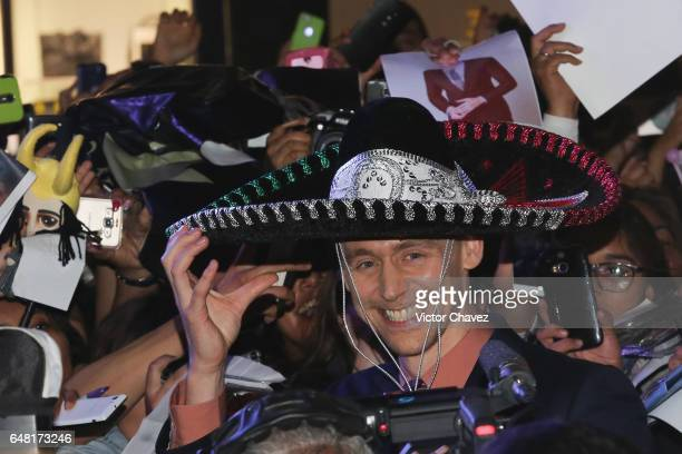 Actor Tom Hiddleston wears a sombrero during the 'Kong Skull Island' Mexico City Premiere at Oasis Coyoacan on March 4 2017 in Mexico City Mexico