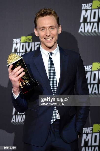 Actor Tom Hiddleston winner of Best Villain for 'Marvel's The Avengers' poses in the press room during the 2013 MTV Movie Awards at Sony Pictures...