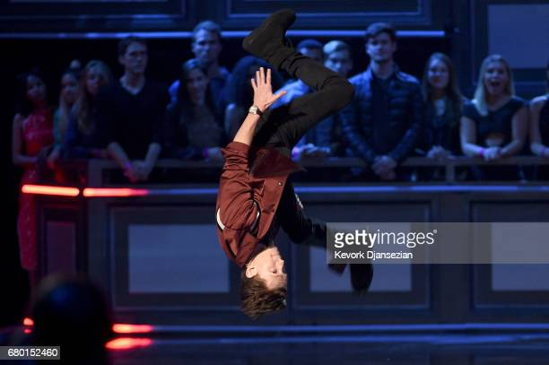 Actor Tom Holland flips onstage during the 2017 MTV Movie And TV Awards at The Shrine Auditorium on May 7 2017 in Los Angeles California