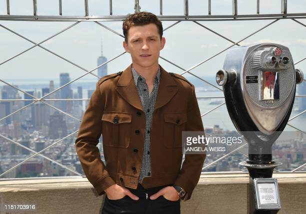 """Actor Tom Holland of """"Spider-Man: Far From Home"""" participates in the ceremonial lighting of the Empire State Building on June 24, 2019 in New York..."""