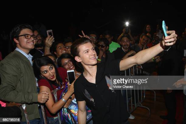 Actor Tom Holland takes selfies with fans during CONQUE to promote the new film SpiderMan Homecoming at Centro De Congresos De Queretaro on May 6...