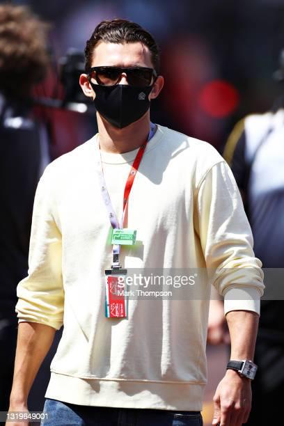 Actor Tom Holland walks in the Pitlane ahead of the F1 Grand Prix of Monaco at Circuit de Monaco on May 23, 2021 in Monte-Carlo, Monaco.