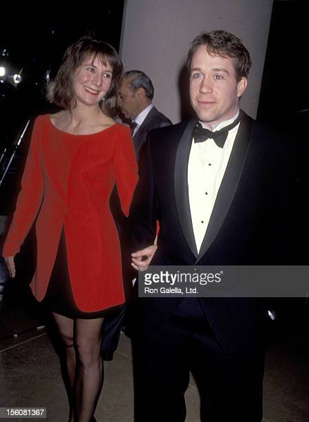 Actor Tom Hulce and guest attend the 48th Annual Golden Globe Awards on January 19 1991 at Beverly Hilton Hotel in Beverly Hills California