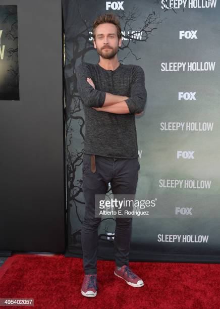 Actor Tom Mison arrives to a special screening of Fox's 'Sleepy Hollow' at Hollywood Forever on June 2 2014 in Hollywood California