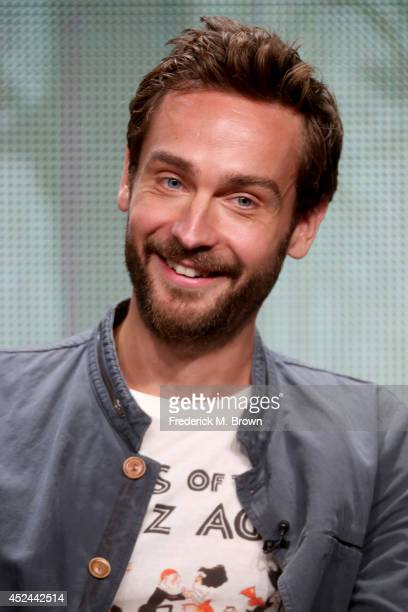 Actor Tom Mison speaks onstage at the 'Sleepy Hollow' panel during the FOX Network portion of the 2014 Summer Television Critics Association at The...