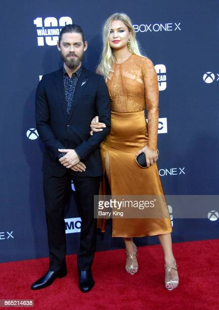 Actor Tom Payne and guest attend AMC Celebrates The 100th Episode of 'The Walking Dead' at The Greek Theatre on October 22 2017 in Los Angeles...