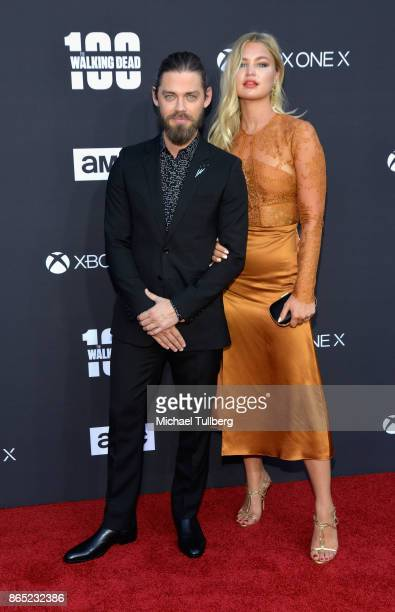 Actor Tom Payne and guest attend AMC's celebration of the 100th episode of 'The Walking Dead' at The Greek Theatre on October 22 2017 in Los Angeles...