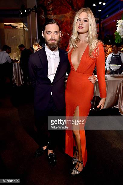 Actor Tom Payne and Jennifer Ackerman attend AMC Networks Emmy Party at BOA Steakhouse on September 18, 2016 in West Hollywood, California.