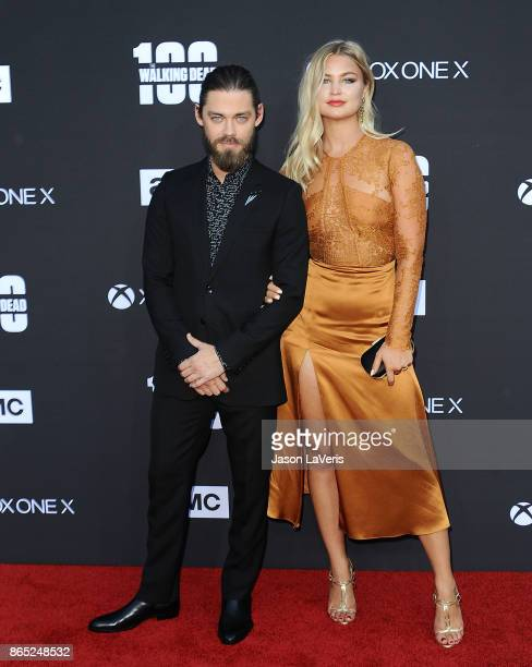 Actor Tom Payne and Jennifer Akerman attend the 100th episode celebration off The Walking Dead at The Greek Theatre on October 22 2017 in Los Angeles...