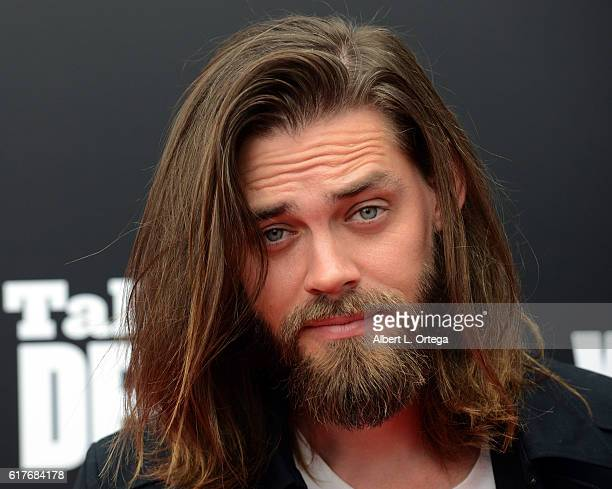 Actor Tom Payne arrives for the AMC Presents Live 90Minute Special Edition Of 'Talking Dead' held at Hollywood Forever on October 23 2016 in...