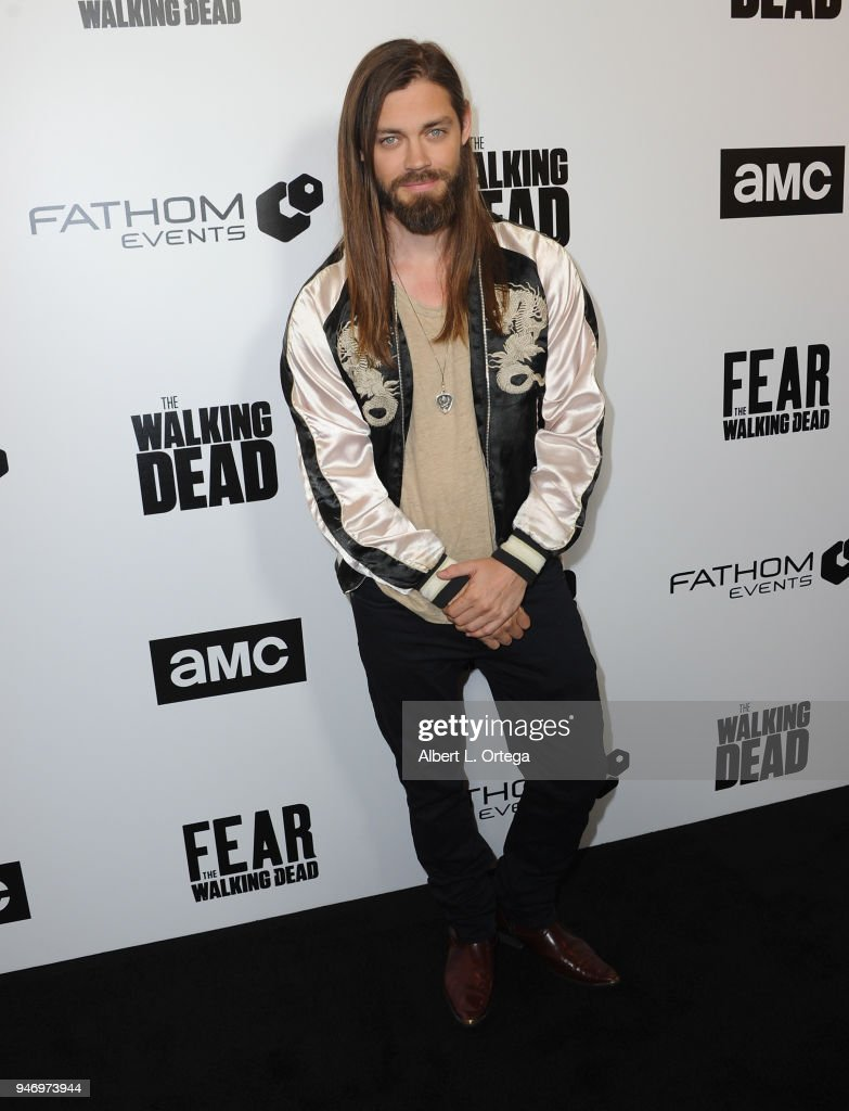 Actor Tom Payne arrives for the Fathom Events And AMC's 'Survival Sunday: The Walking Dead And Fear The Walking Dead' held at AMC Century City 15 theater on April 15, 2018 in Century City, California.