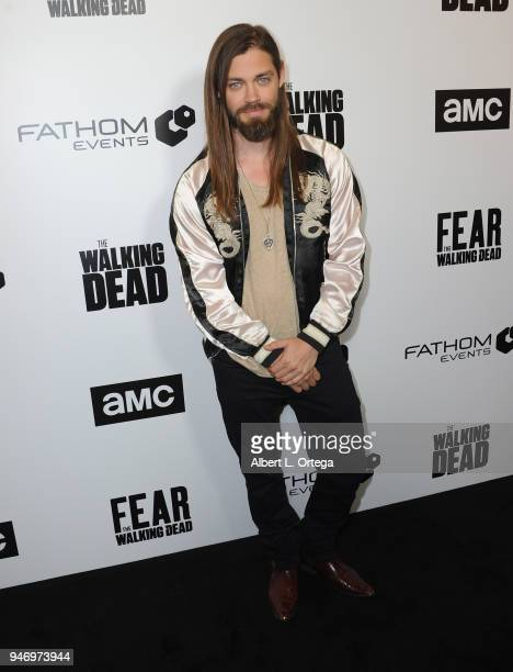 Actor Tom Payne arrives for the Fathom Events And AMC's Survival Sunday The Walking Dead And Fear The Walking Dead held at AMC Century City 15...