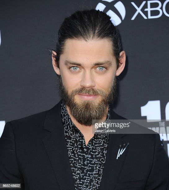 Actor Tom Payne attends the 100th episode celebration off The Walking Dead at The Greek Theatre on October 22 2017 in Los Angeles California