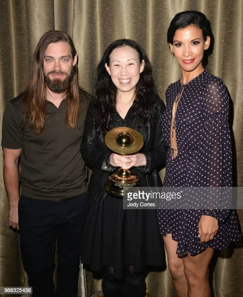 Actor Tom Payne producer Angela Kang and actress Danay Garcia pose backstage at the Academy Of Science Fiction Fantasy Horror Films' 44th Annual...
