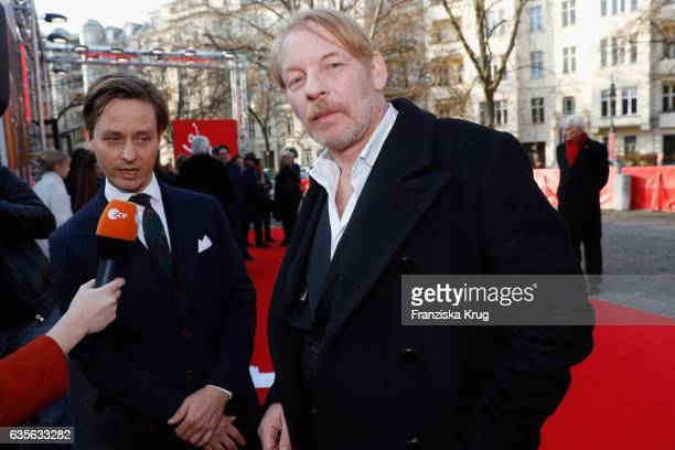 Actor Tom Schilling and actor Ben Becker talk to the press at the 'Der Gleiche Himmel' premier during the 67th Berlinale International Film Festival...